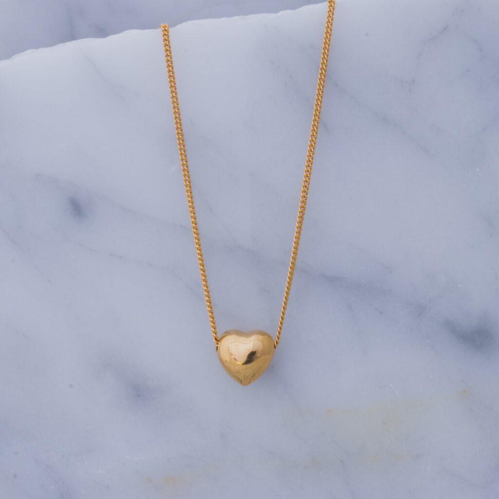 collar corazon oro globo